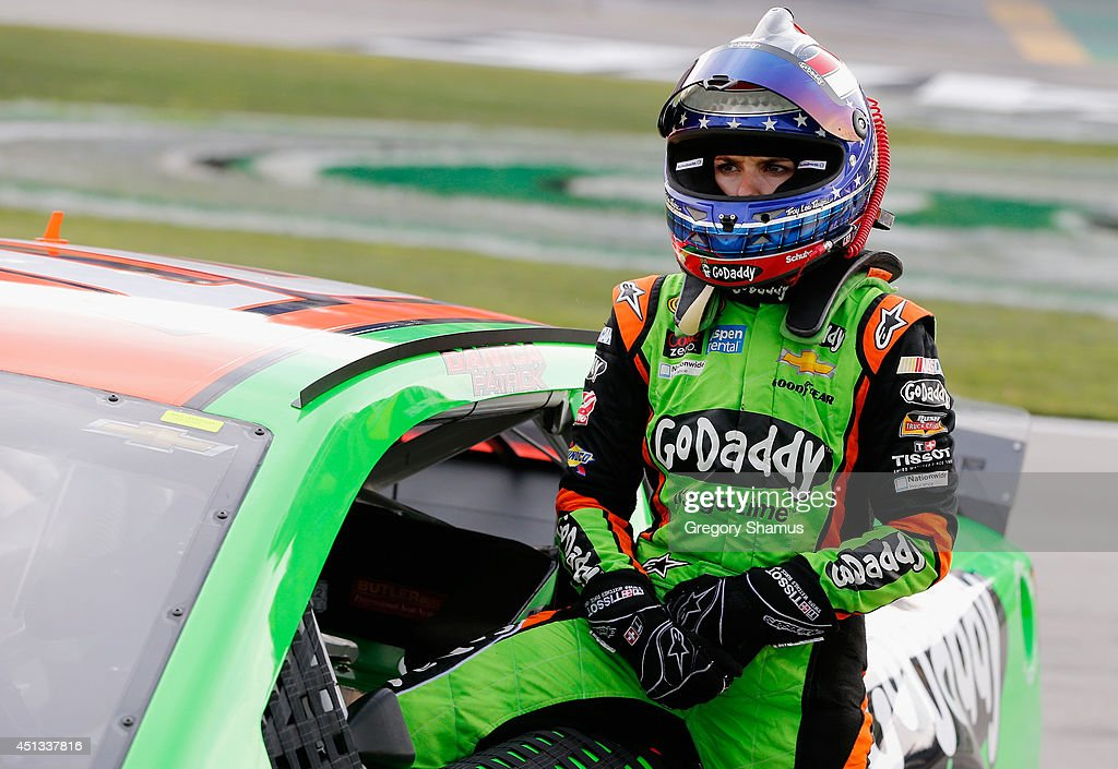 Danica Patrick, driver of the #10 GoDaddy Chevrolet, stands on the grid during qualifying for the NASCAR Sprint Cup Series Quaker State 400 presented by Advance Auto Parts at Kentucky Speedway on June 27, 2014 in Sparta, Kentucky.