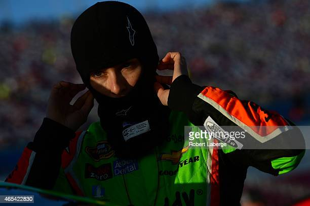 Danica Patrick driver of the GoDaddy Chevrolet stands on the grid during qualifying for the NASCAR Sprint Cup Series Kobalt 400 at Las Vegas Motor...