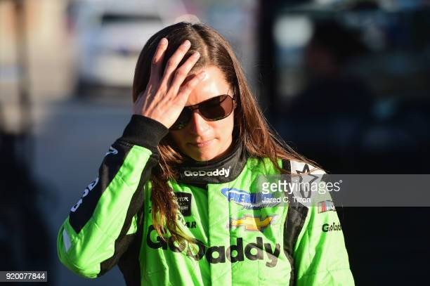Danica Patrick driver of the GoDaddy Chevrolet walks from the infield care center after being involved in an ontrack incident the Monster Energy...