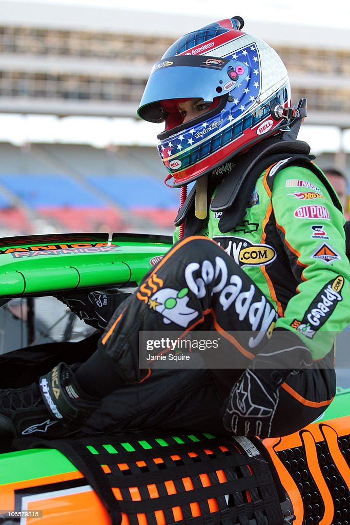 Danica Patrick, driver of the #7 GoDaddy.com Chevrolet, climbs out of her car after qualifying for the NASCAR Nationwide Series O'Reilly Auto Parts Challenge at Texas Motor Speedway on November 5, 2010 in Fort Worth, Texas.