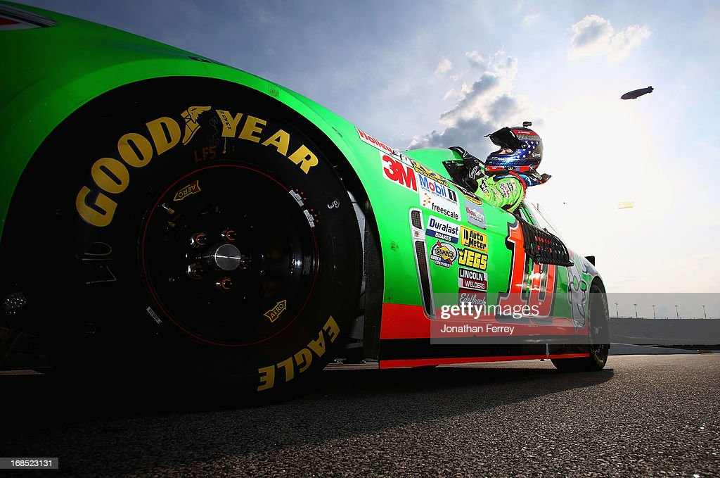 Danica Patrick, driver of the #10 GoDaddy.com Chevrolet, climbs out of her car during qualifying for the NASCAR Sprint Cup Series Bojangles' Southern 500 at Darlington Raceway on May 10, 2013 in Darlington, South Carolina.