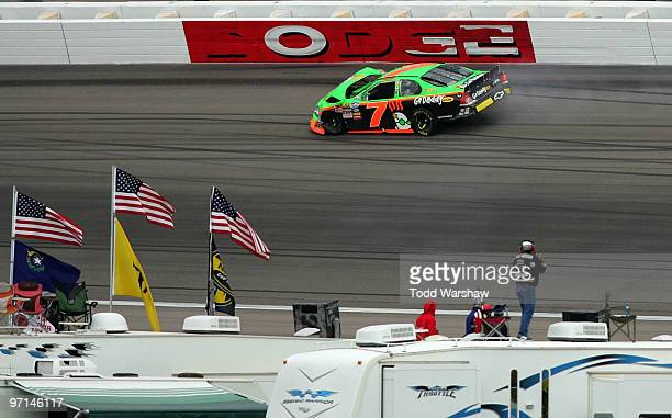 Danica Patrick driver of the GoDaddycom Chevrolet drives away after colliding with Michael McDowell driver of the Monte Carlo Resort Casino Dodge...