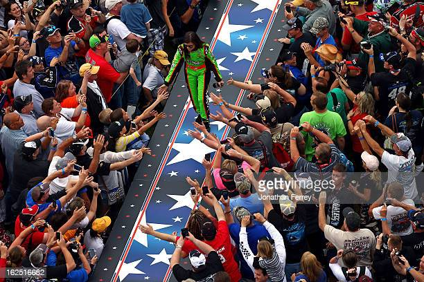 Danica Patrick driver of the GoDaddycom Chevrolet highfives the crowd during driver introductions prior to the NASCAR Sprint Cup Series Daytona 500...