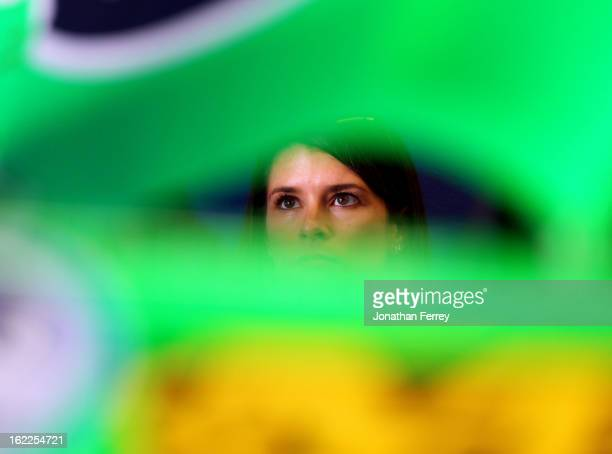 Danica Patrick driver of the GoDaddycom Chevrolet looks on in the garage during practice for the NASCAR Nationwide Series DRIVE4COPD 300 at Daytona...