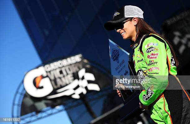 Danica Patrick, driver of the GoDaddy.com Chevrolet, poses after winning the pole award for the NASCAR Sprint Cup Series Daytona 500 at Daytona...