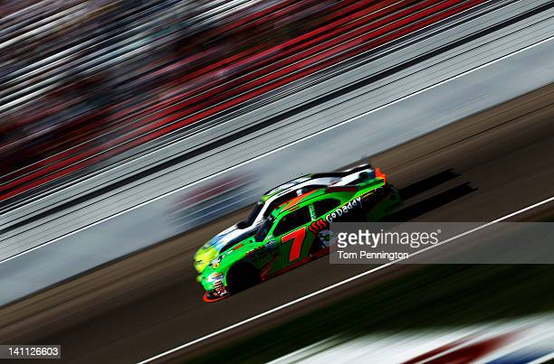 Danica Patrick driver of the GoDaddycom Chevrolet races Blake Koch driver of the Poyntcom Ford during the NASCAR Nationwide Series Sam's Town 300 at...