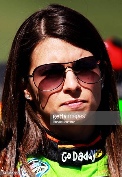 Danica Patrick driver of the GoDaddycom Chevrolet stands on the grid during qualifying for the NASCAR Nationwide Series Sam's Town 300 at Las Vegas...
