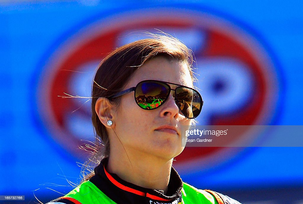 Danica Patrick, driver of the #10 GoDaddy.com Chevrolet, stands on the grid during qualifying for the NASCAR Sprint Cup Series STP Gas Booster 500 on April 5, 2013 at Martinsville Speedway in Ridgeway, Virginia.