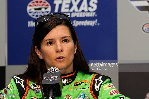 Danica Patrick driver of the GoDaddycom /DanWheldonMemorialcom Chevrolet speaks at a press conference announcing her donation to the auction...