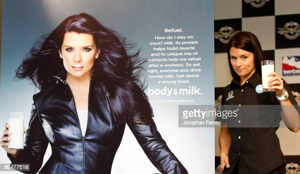 Danica Patrick driver of the Motorola Andretti Green Racing Dallara Honda poses with some milk beside her new 'Got Milk' ad campaign poster before...