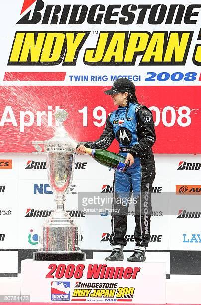 Danica Patrick driver of the Motorola Andretti Green Racing Honda Dallara sprays champagne after winning the IndyCar Series Bridgestone Indy Japan...