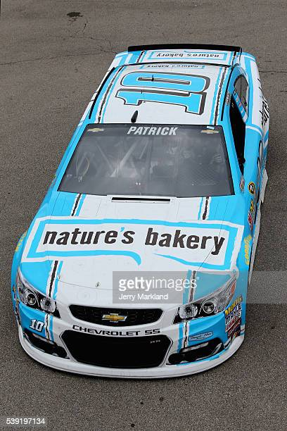 Danica Patrick driver of the Nature's Bakery Chevrolet drives through the garage area during practice for the NASCAR Sprint Cup Series FireKeepers...