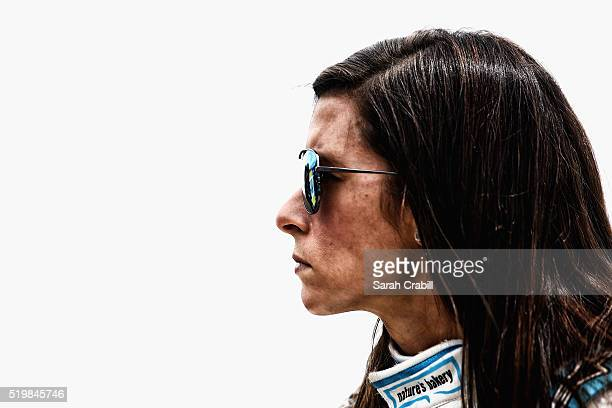 Danica Patrick driver of the Nature's Bakery Chevrolet stands on the grid during qualifying for the NASCAR Sprint Cup Series Duck Commander 500 at...