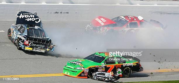 Danica Patrick driver of the No 7 Go Daddy Chevrolet runs into a multicar crash involving Colin Braun No 16 Ricky Stenhouse Jr and Josh Wise No 61...