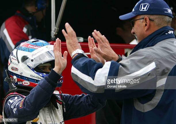 Danica Patrick driver of the Rahal Letterman Racing Argent Pioneer Panoz Honda talks to team owner Bobby Rahal in the pits during Pole Day Qualifying...
