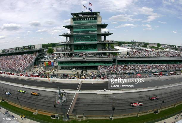 Danica Patrick driver of the Rahal Letterman Racing Argent Pioneer Panoz Honda leads Dan Wheldon driver of the Klein Tools/Jim Beam Andretti Green...