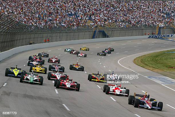 Danica Patrick driver of the Rahal Letterman Racing Argent Pioneer Panoz Honda leads the rest of the field at the start of the Indy Racing League...