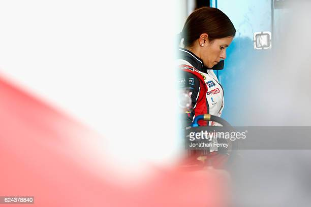 Danica Patrick driver of the TaxACT Chevrolet stands in the garage area during practice for the NASCAR Sprint Cup Series Ford EcoBoost 400 at...