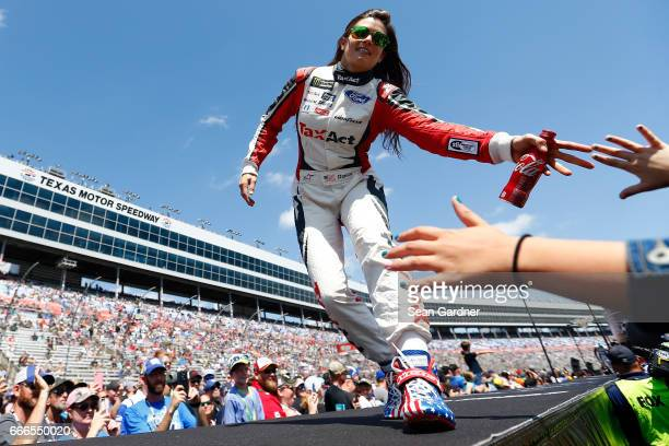 Danica Patrick driver of the TaxAct Ford greets fans during driver introductions prior to the Monster Energy NASCAR Cup Series O'Reilly Auto Parts...
