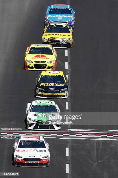 Danica Patrick driver of the TaxAct Ford leads a pack of cars during the Monster Energy NASCAR Cup Series O'Reilly Auto Parts 500 at Texas Motor...
