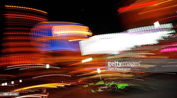 Danica Patrick driver of the Team Go Daddy Andretti Autosport Dallara Honda drives a parade lap down the Las Vegas Boulevard Strip as a preview to...