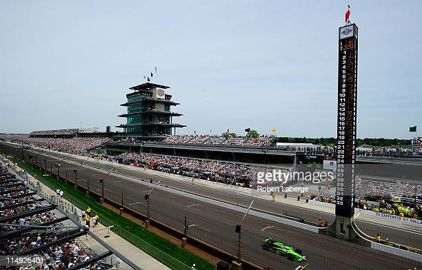 Danica Patrick, driver of the Team GoDaddy Dallara Honda, races during the IZOD IndyCar Series Indianapolis 500 Mile Race at Indianapolis Motor...