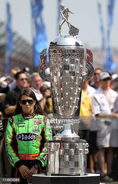 Danica Patrick driver of the Team GoDaddy Dallara Honda stands next to the BorgWarner Trophy prior to the IZOD IndyCar Series Indianapolis 500 Mile...