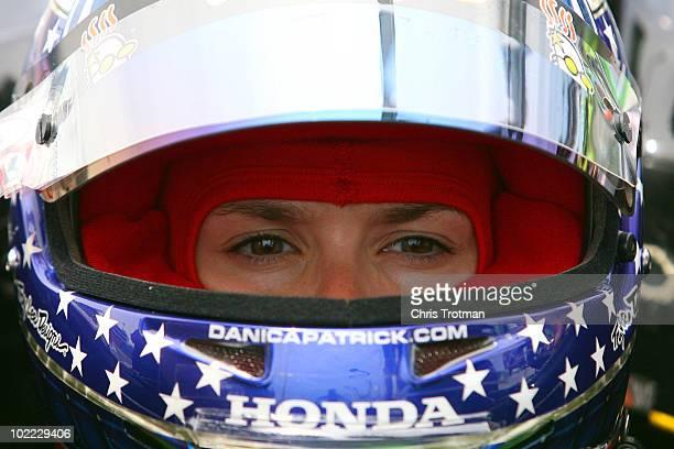 Danica Patrick driver of the Team Godaddycom Andretti Autosport Dallara Honda sits in her car during practice for the IRL Indycar Series Iowa Corn...