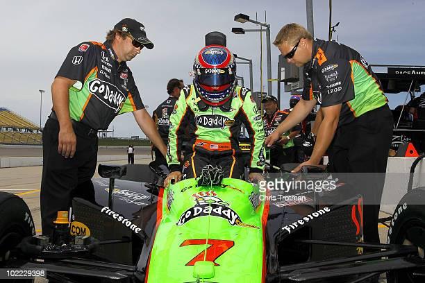 Danica Patrick driver of the Team Godaddycom Andretti Autosport Dallara Honda gets into her car during practice for the IRL Indycar Series Iowa Corn...