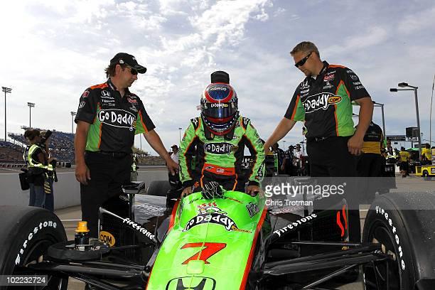 Danica Patrick driver of the Team Godaddycom Andretti Autosport Dallara Honda gets into her car during qualifying for the IRL Indycar Series Iowa...