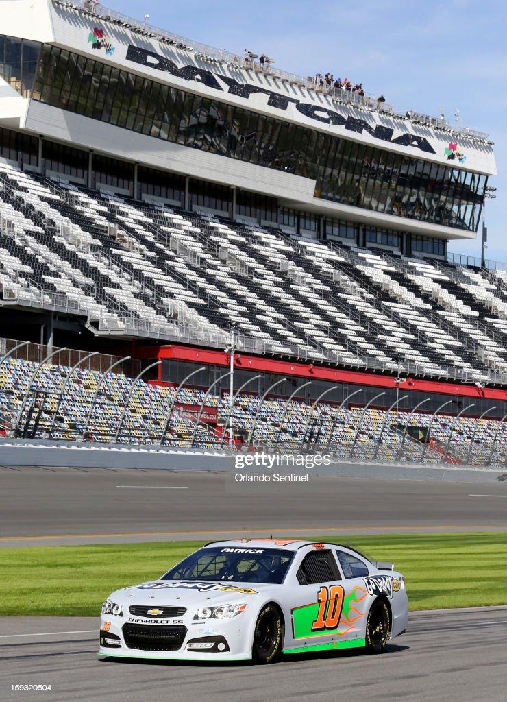 Danica Patrick drives on pit row during test trials at Daytona International Speedway in Daytona Beach, Florida, Friday, January 11, 2013.