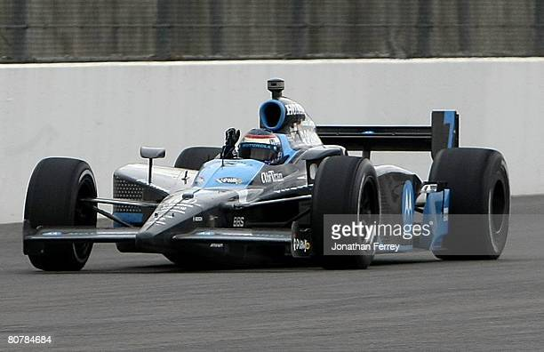 Danica Patrick in her Motorola Andretti Green Racing Honda Dallara pumps her fist as she crosses the finish line to win the IndyCar Series...