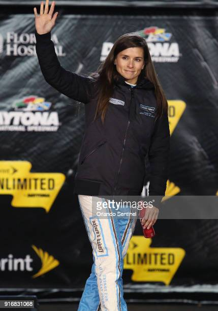 Danica Patrick waves during driver introductions before the start of the Sprint Unlimited NASCAR Sprint Cup Series race at Daytona International...