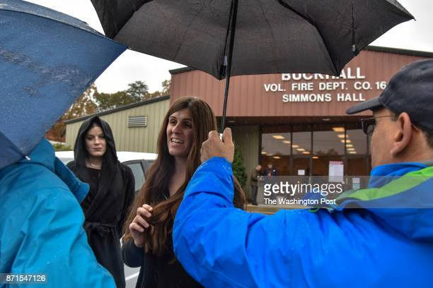Danica Roem C who is running for house of delegates against GOP incumbent Robert Marshall chats with poll workers after casting her own vote at...