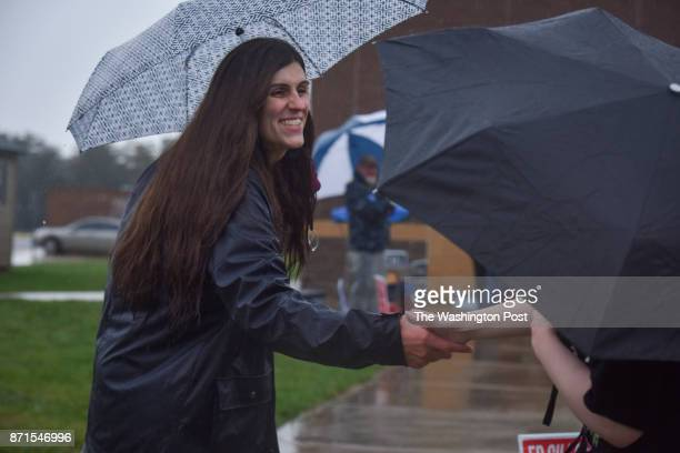 Danica Roem who is running for house of delegates against GOP incumbent Robert Marshall campaigns as voters take to the ballot boxes at Gainesville...
