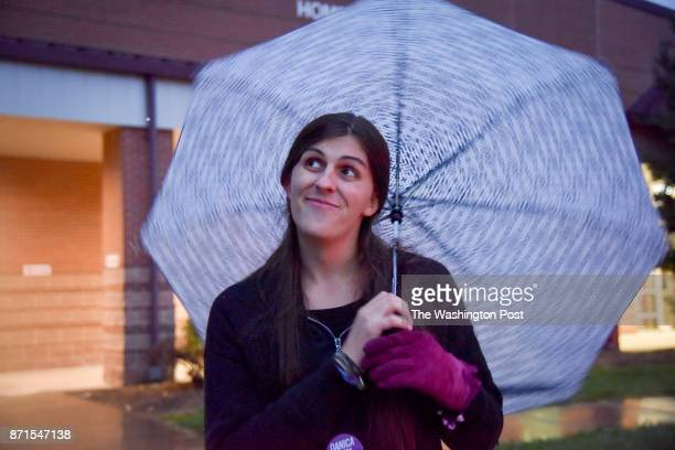 Danica Roem who is running for house of delegates against GOP incumbent Robert Marshall twirls her umbrella in the rain as she campaigns at Spring...
