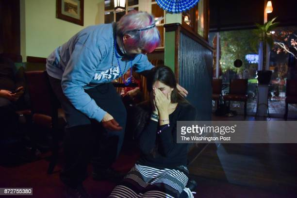 Danica Roem who ran for house of delegates against GOP incumbent Robert Marshall falls to her knees after getting a call from Joe Biden...