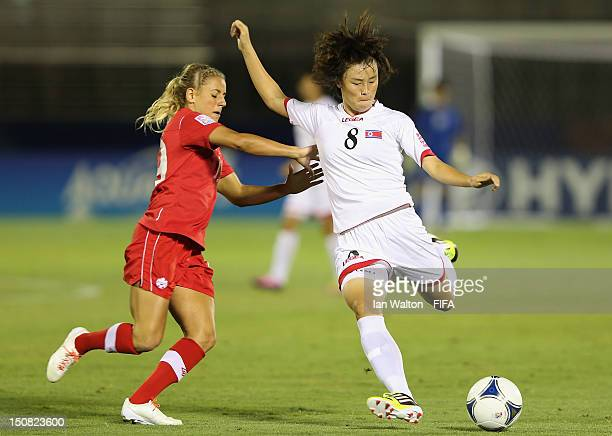 Danica Wu of Canada competes for the ball with Jon Myong Hwa of Korea DPR during the FIFA U20 Women's World Cup Japan 2012 Group C match between...