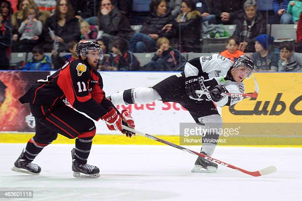 Danick Martel of the BlainvilleBoisbriand Armada shoots the puck in front of Maxime Fournier of the Baie Comeau Drakkar during the QMJHL game at...
