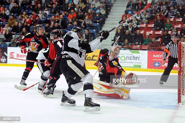 Danick Martel of the BlainvilleBoisbriand Armada shoots the puck on Philippe Cadorette of the Baie Comeau Drakkar during the QMJHL game at Centre...