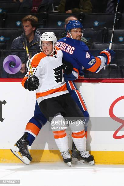 Danick Martel of the Philadelphia Flyers checks Dennis Seidenberg of the New York Islanders in his first NHL game at Barclays Center on November 22...