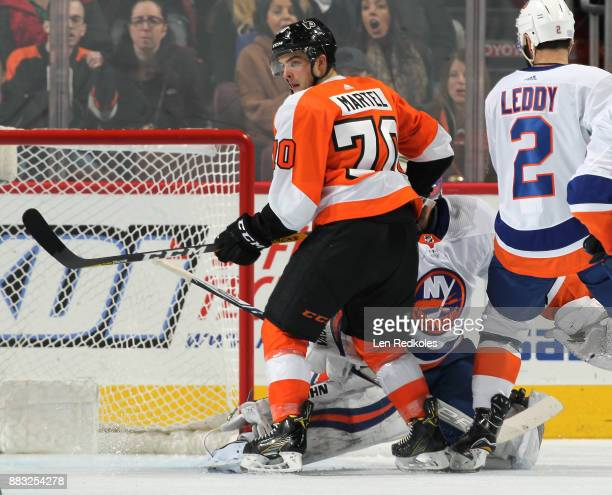 Danick Martel of the Philadelphia Flyers creates traffic in the crease against Thomas Greiss and Nick Leddy of the New York Islanders on November 24...