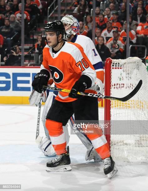 Danick Martel of the Philadelphia Flyers screens goaltender Thomas Greiss of the New York Islanders on November 24 2017 at the Wells Fargo Center in...