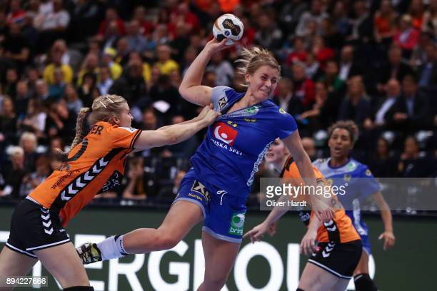 Danick Snelder of Netherlands and Isabelle Gullden of Sweden challenges for the ball during the IHF Women's Handball World Championship 3rd place...