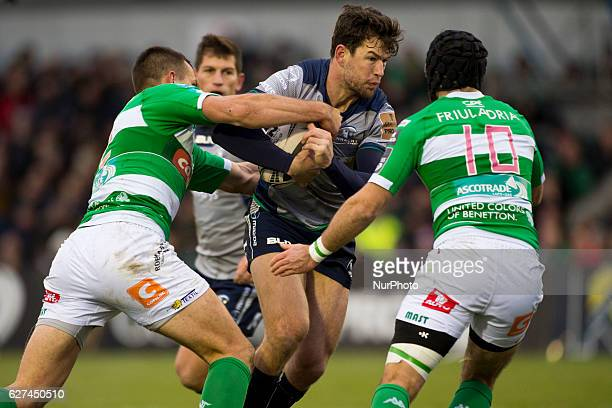 Danie Poolman of Connacht tackled by Ian McKinley and Alberto Sgarbi of Benetton during the Guinness PRO12 Round 10 match between Connacht Rugby and...