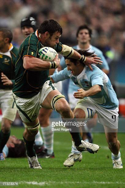 Danie Rossouw of South Africa holds off the tackle of Agustin Pichot of Argentina during the Rugby Word Cup Semi Final between South Africa and...