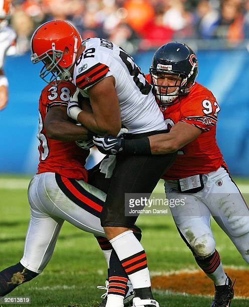 Danieal Manning and Hunter Hillenmeyer of the Chicago Bears tackle Steve Heiden of the Cleveland Browns at Soldier Field on November 1 2009 in...