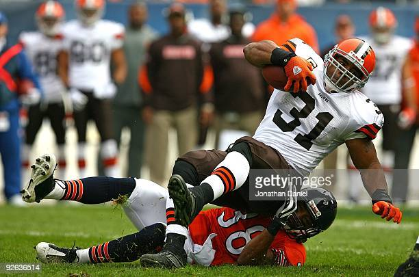 Danieal Manning of the Chicago Bears takes down Jamal Lewis of the Cleveland Browns at Soldier Field on November 1 2009 in Chicago Illinois The Bears...