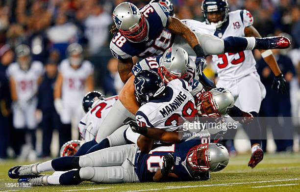Danieal Manning of the Houston Texans gets tackled by Matthew Slater Niko Koutouvides Marquice Cole and Brandon Bolden of the New England Patriots...