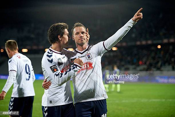Daniel A Pedersen and Kim Aabech of AGF Aarhus celebrates after scoring their second goal during the Danish Alka Superliga match between AGF Aarhus...